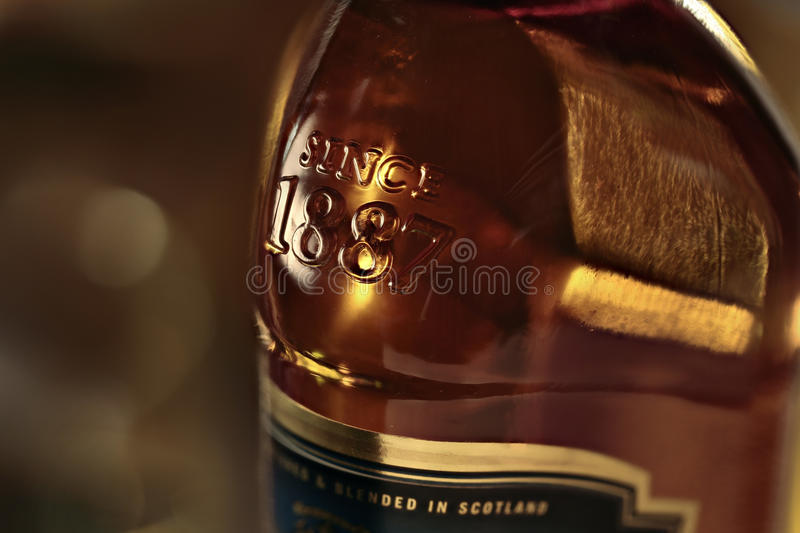 Black and Beige 1887 Labeled Glass Bottle royalty free stock photos