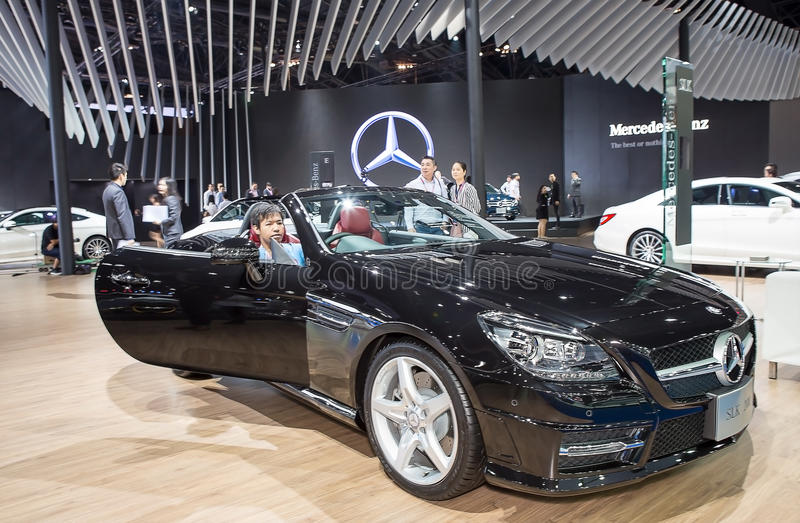 Black Benz series SLK 200 and unidentified customer. Bangkok - March 22 : black Benz series SLK 200 and unidentified customer - in display at The 37th Bangkok stock photos