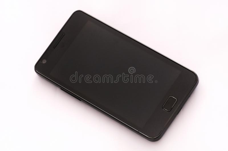 A black bezel smartphone. A photo taken on a black bezel smartphone against a white backdrop royalty free stock images