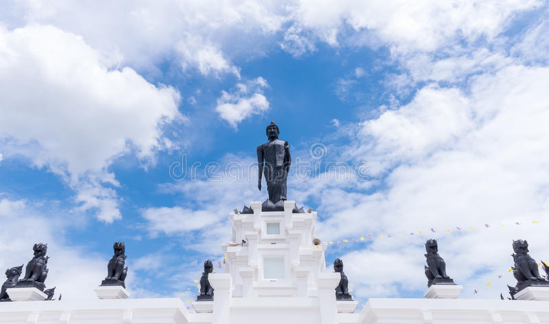Black Big Buddha statue with white cloudy and blue sky royalty free stock photography