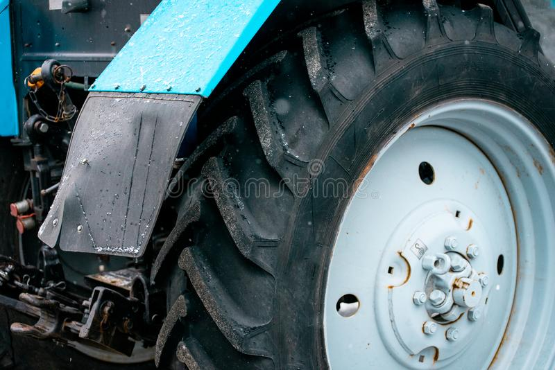 Black big wheel from the tractor. Snowblower royalty free stock images