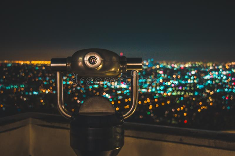 Black Binocular Facing Lighted City at Nighttime stock photo