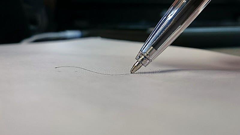 Black biro pen on paper. stock photography