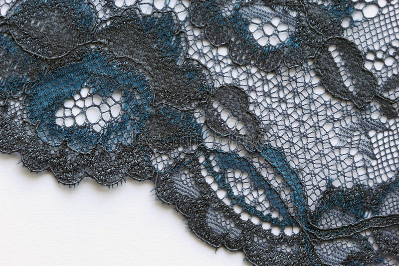Black and blue flowers lace material texture macro shot royalty free stock photos