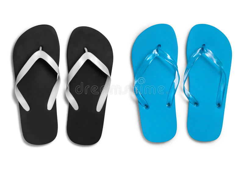 Black and blue rubber slippers on white background with clipping path. Photo take on 2016 stock photography