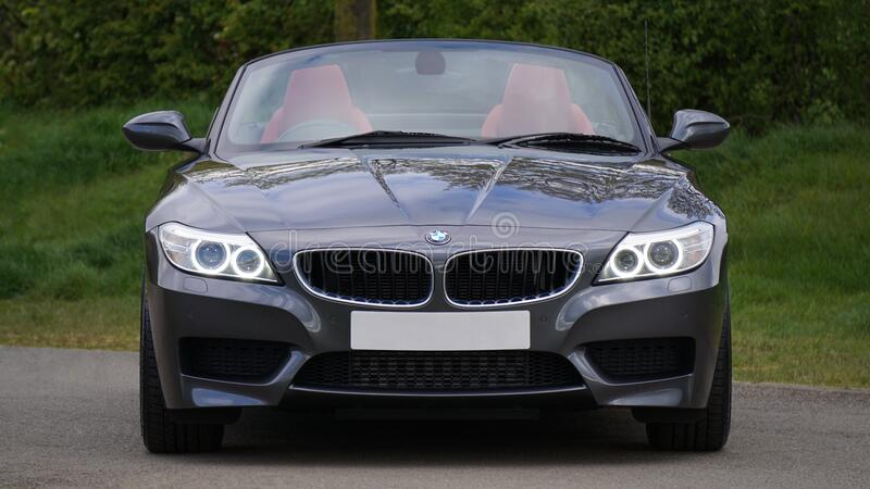 Black Bmw Convertible In Front Of Green Bushes Free Public Domain Cc0 Image