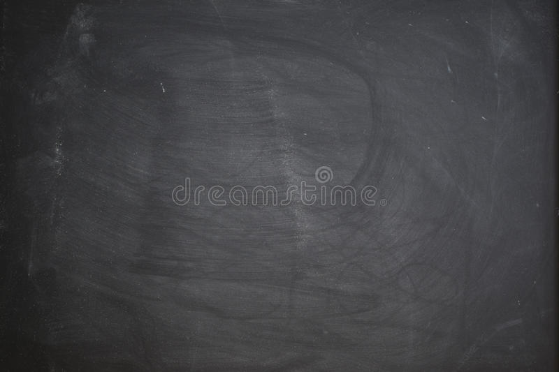 Black board with chalk rubbed out for background. royalty free stock image