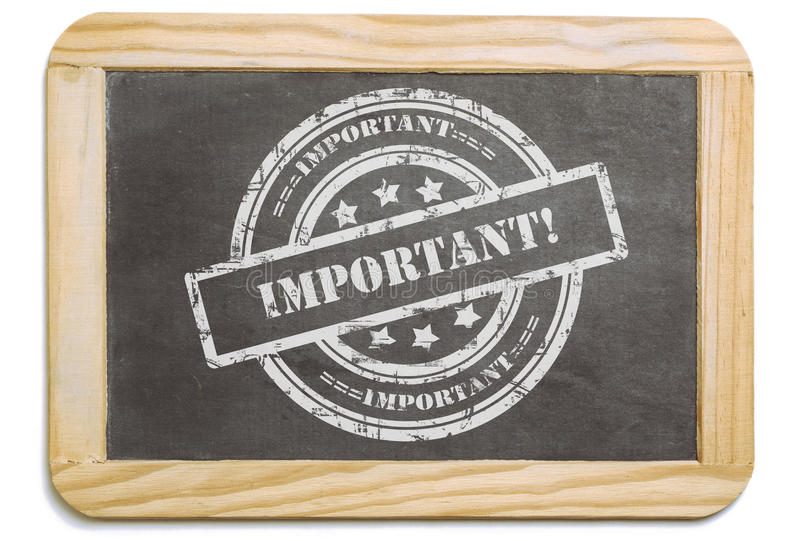 Black board with layered chalk message. Black board with wooden frame, layered grund design chalk message in stamp form: Important. Isolated on white background stock photos