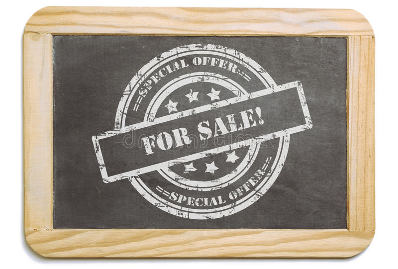 Black board with layered chalk message. Black board with wooden frame, layered grund design chalk message in stamp form: For Sale, special offer. Isolated on stock photography