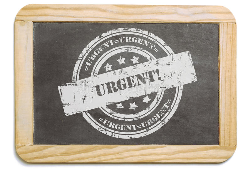 Black board with layered chalk message. Black board with wooden frame, layered grund design chalk message in stamp form: Urgent. Isolated on white background stock photo