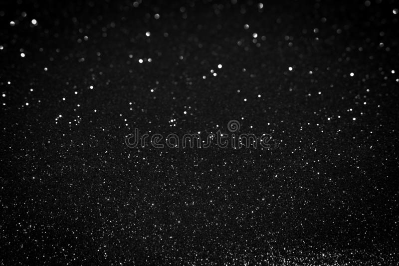Silver bokeh texture on black background stock image