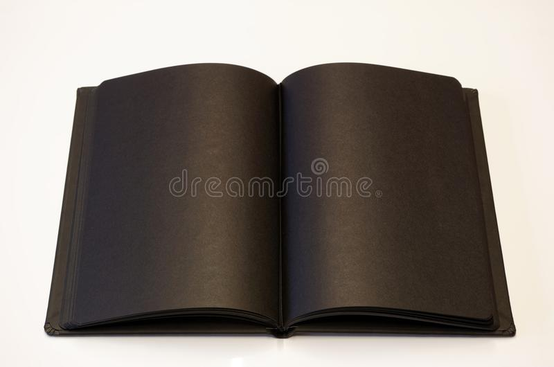 Black book lying open on white background. No text, just empty letters royalty free stock photos