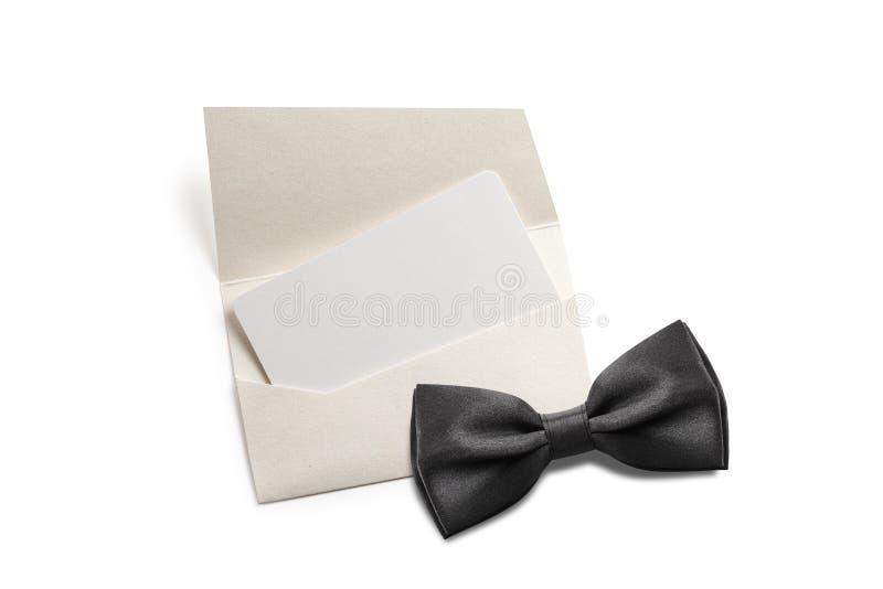 Black bow tie. With blank invitation royalty free stock photo