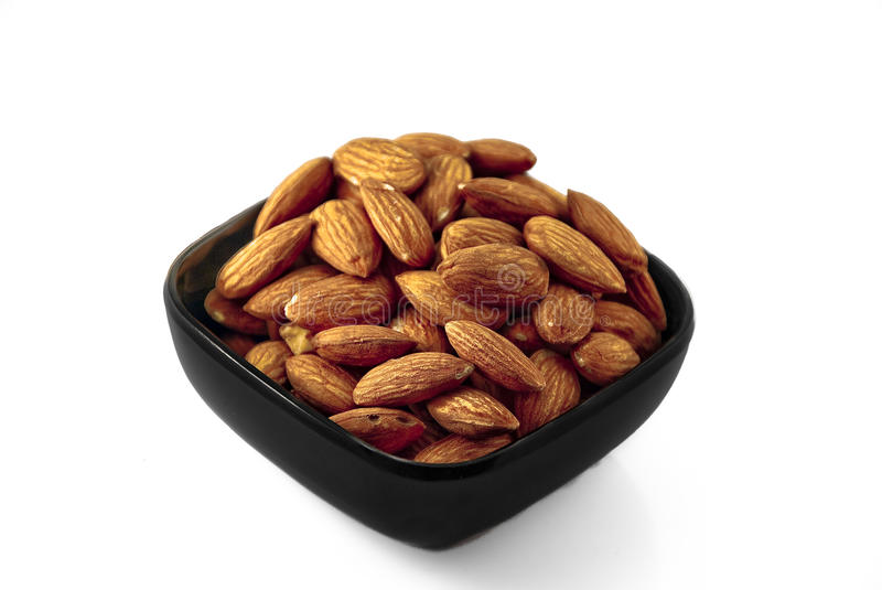 Download Black Bowl of Almonds stock photo. Image of edible, isolated - 10089036