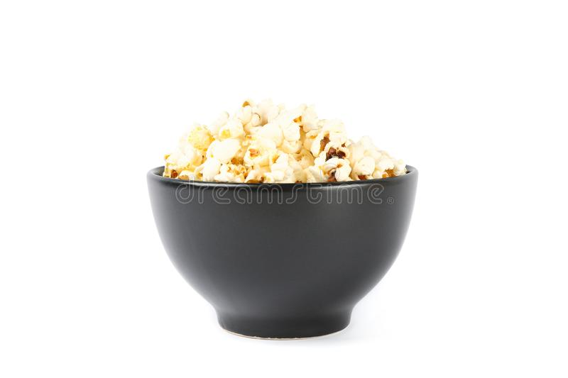 Black bowl with popcorn isolated on white. Background royalty free stock photos