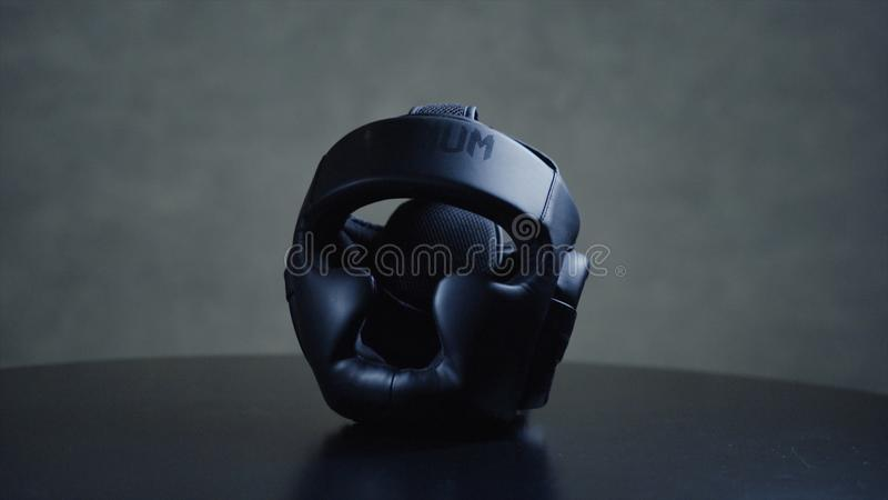 Black boxer helmet on the table. Protective helmet on the head during training protects the head from bumps royalty free stock photos