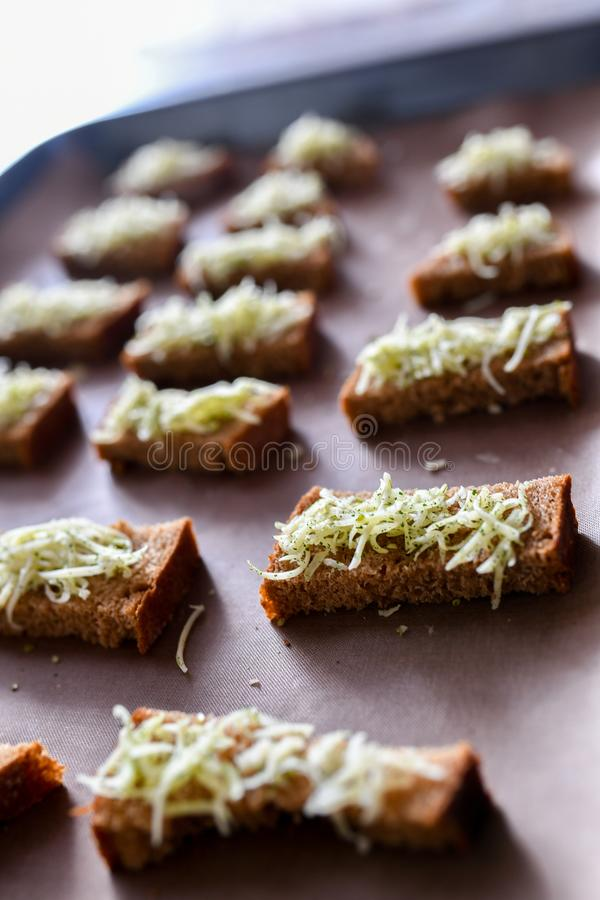 Black bread croutons, cheese with spices. toast on the stove royalty free stock image