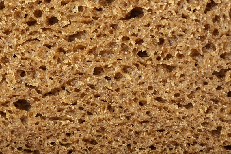 Black bread cut. Close-up. well-visible texture of bread stock photography