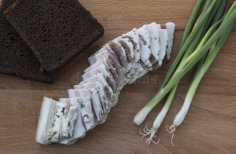 Black bread, lard, green onions royalty free stock photography