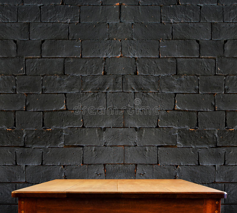 Background with grunge black wall and wooden table deck ...