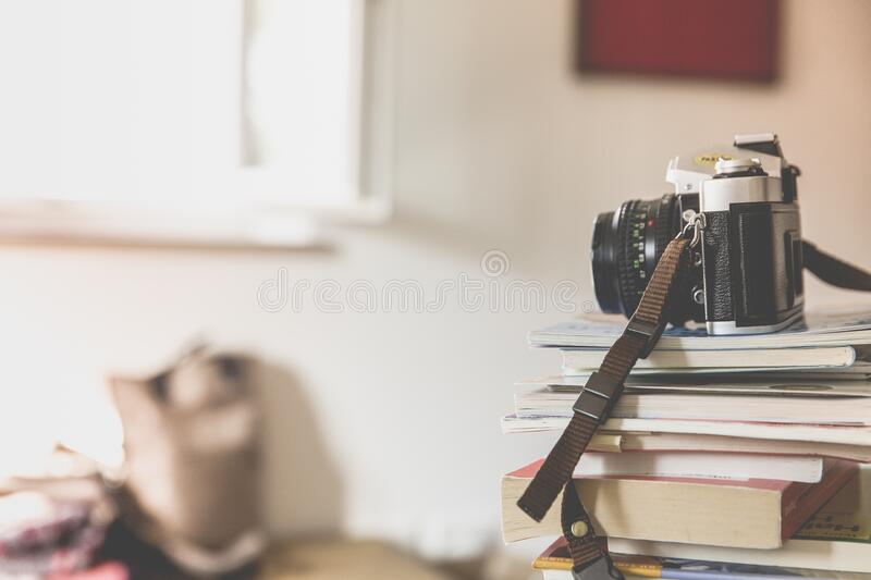 Black Bridge Camera on Top of Piled Books stock photos
