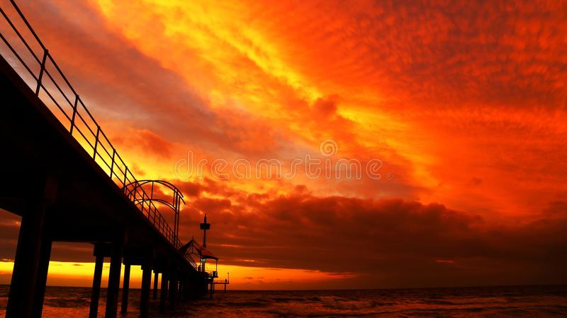 Black Bridge Under Orange Sky during Sunset royalty free stock photography