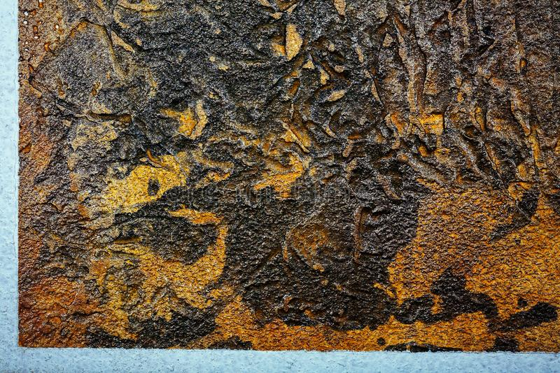 Wall decor texture. Black with brown bumpy wall stucco texture background. Decorative wall paint royalty free stock photography