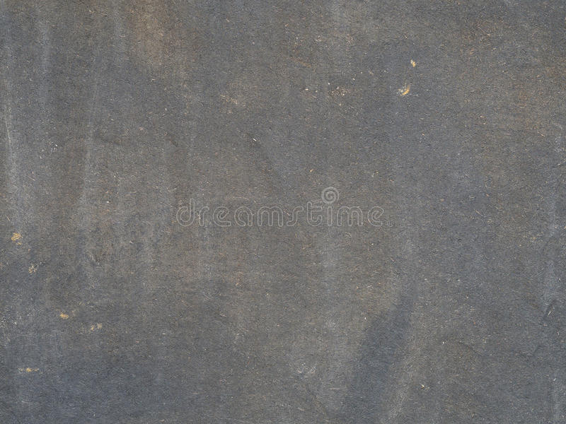 Black brown painted chipboard desk background. Faded black brown painted chipboard desk background royalty free stock image