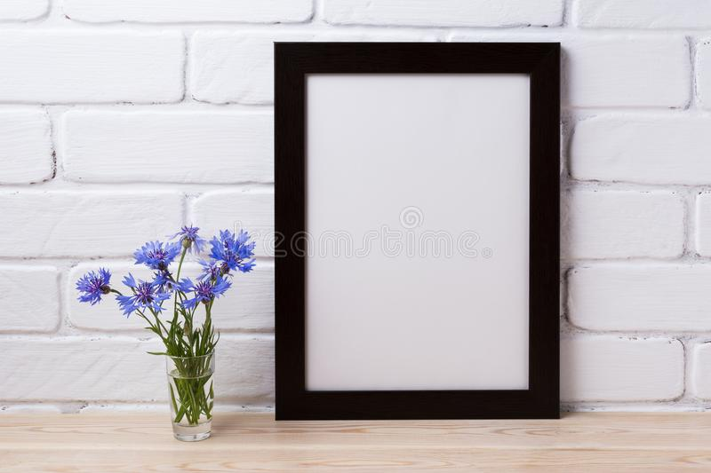 Black brown poster frame mockup with cornflower stock photography