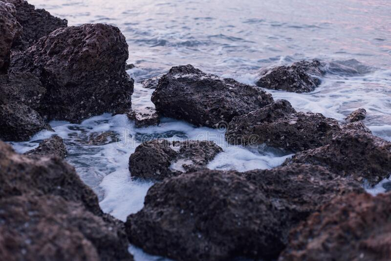 Black And Brown Rocks On Sea During Daylight Free Public Domain Cc0 Image