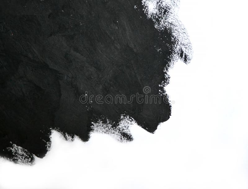 Black brush strokes oil paints on white paper royalty free stock images