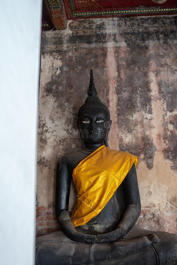 Black Buddha statue in Wat Suthat Thepphawararam the royal temple of the first grade in Bangkok. Construction of the temple was completed in 1847. Bangkok stock photo