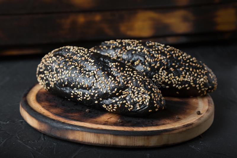 Black bun with sesame on the table royalty free stock photography