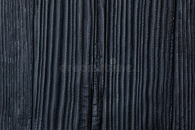 Black Burned & Charred Wood, Cedar Or Pine House Siding Backgrou royalty free stock photos