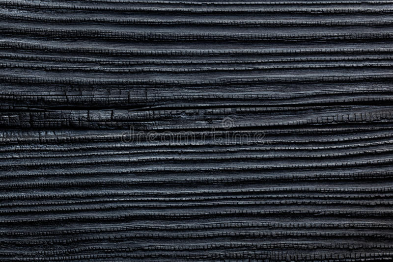 Black Burned & Charred Wood Cedar Pine House Siding Background stock photography