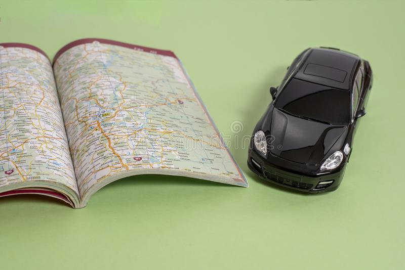 Black business class toy car and road map in book version royalty free stock image