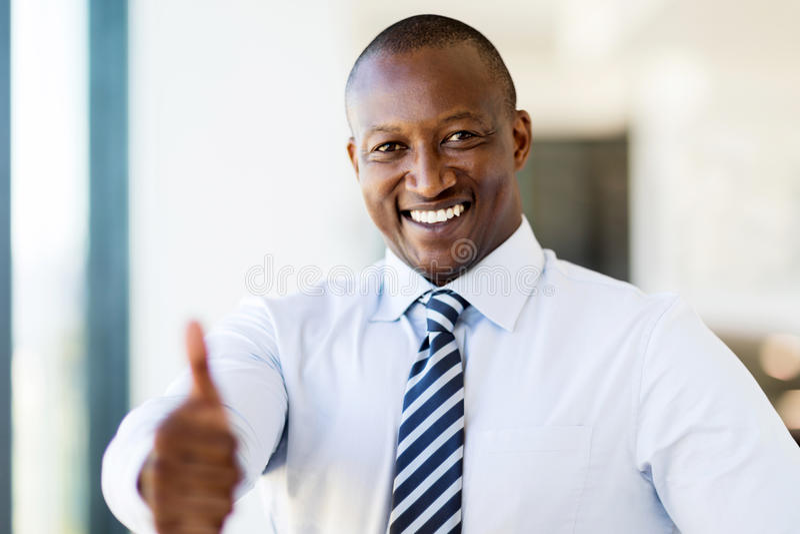 Black business man thumb up stock photo