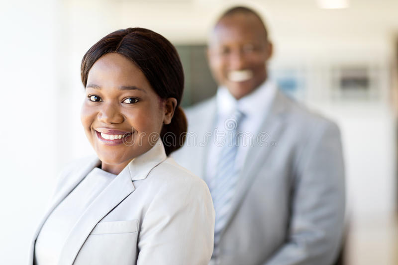 Black business woman. Attractive black business women looking at the camera royalty free stock photos