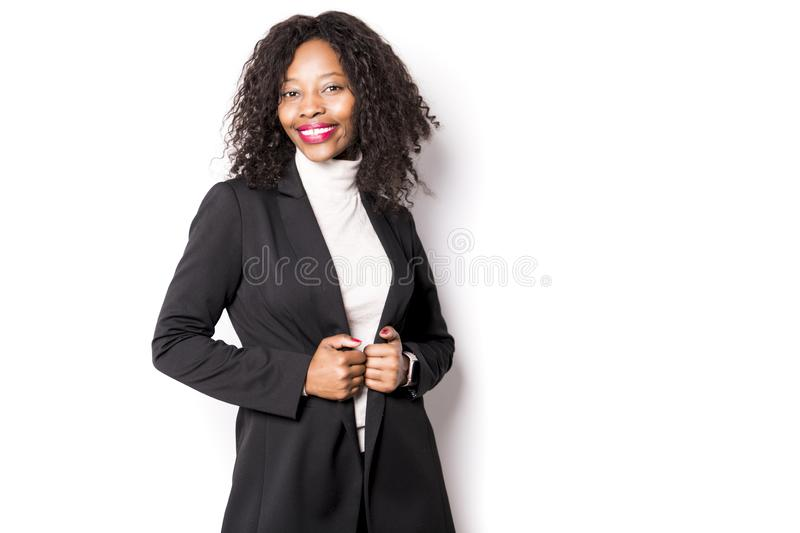 A black business woman poses for a portrait on studio white stock photography