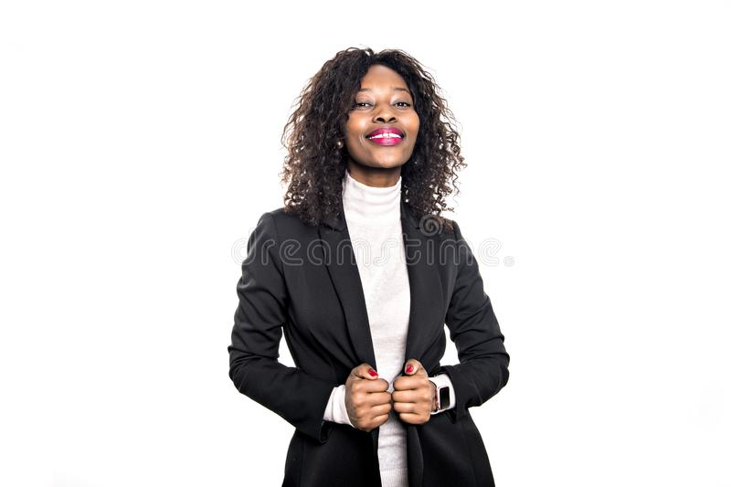 Black business woman poses for a portrait on studio white stock photography