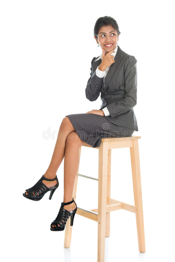 Black business woman seated on chair. royalty free stock image