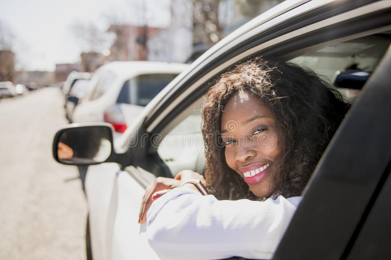 Black Business woman on a white car royalty free stock photography
