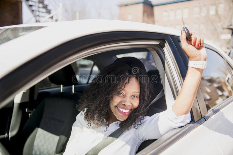 Black Business woman on a white car stock photography