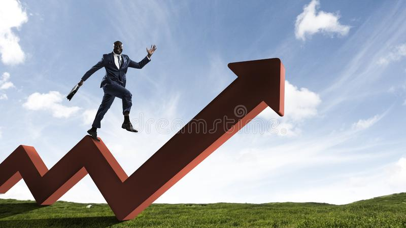 Black businessman running on red zigzag increasing arrow. On sunny valley landscape background stock photos