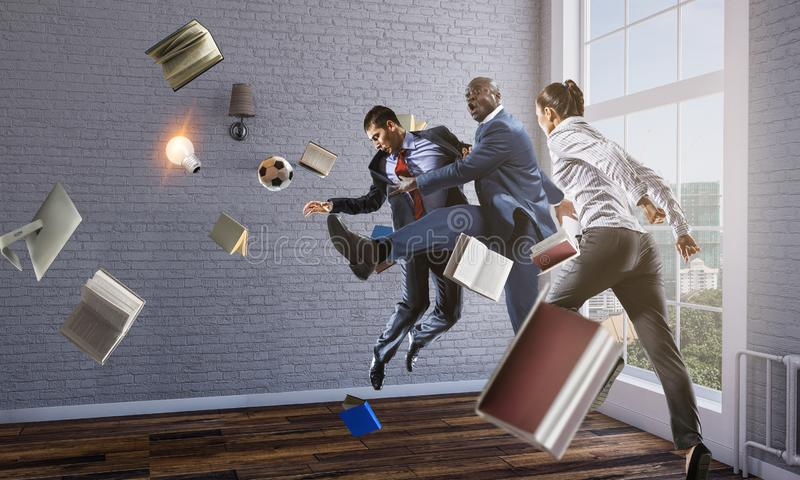 Black businessman in a suit playing footbal royalty free stock photography