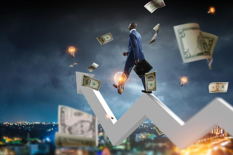 Black businessman on white zigzag increasing arrow surrounded by flying dollar banknotes and burning lamps on a dark royalty free stock image