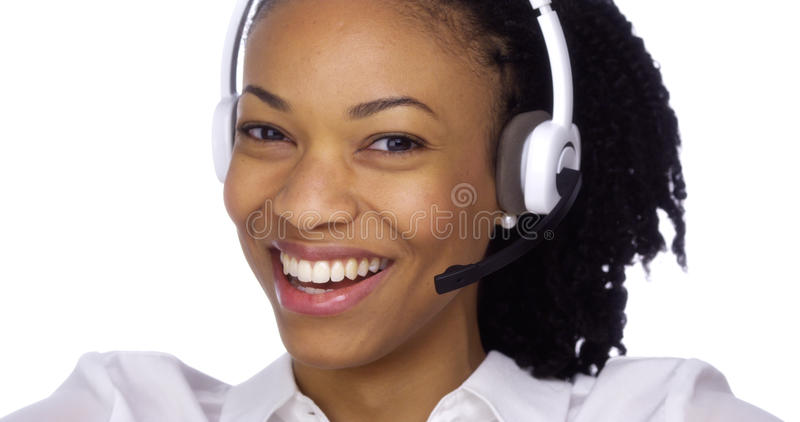 Black businesswoman smiling with headset royalty free stock image