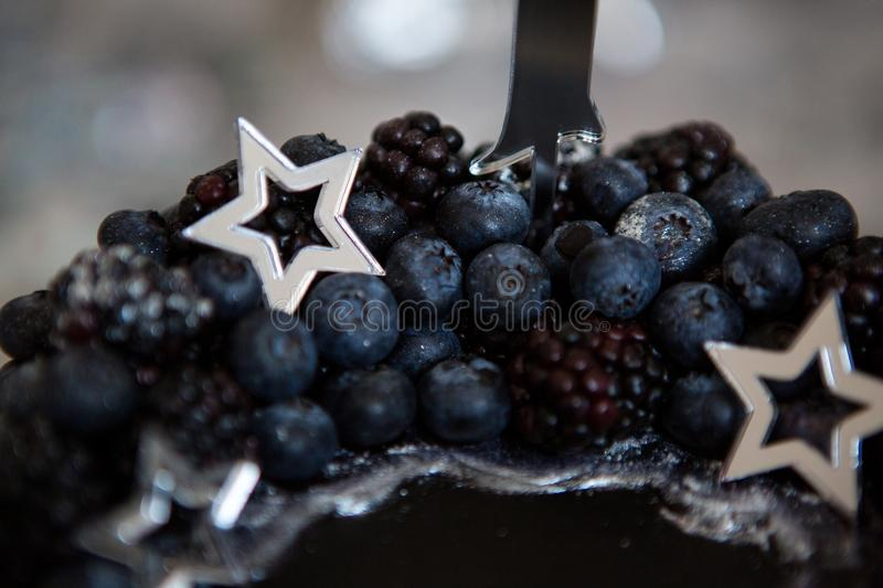 Black cake with stars and berries. With the number one stock photo