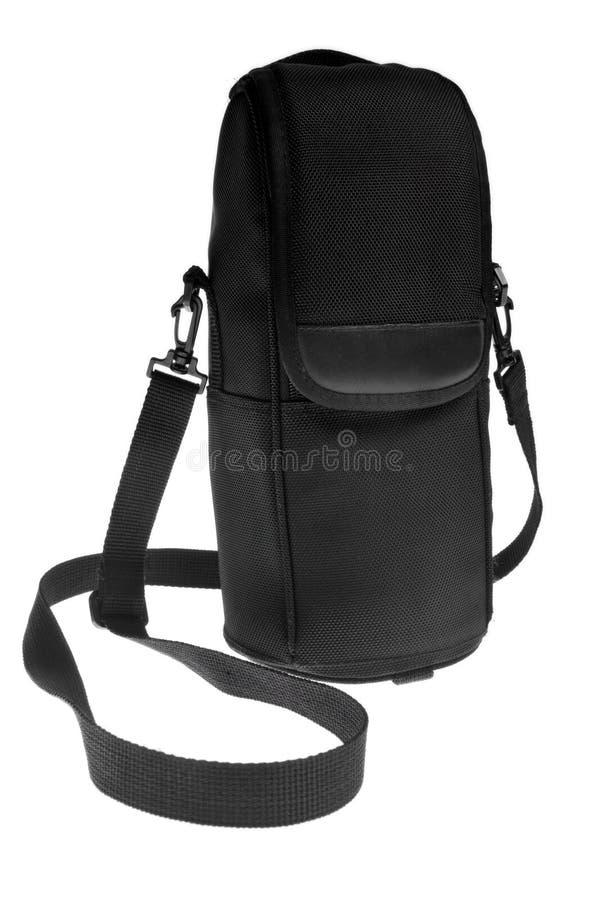 Black camera lens protection case. Black DSLR camera lens protection case isolated on white background stock image