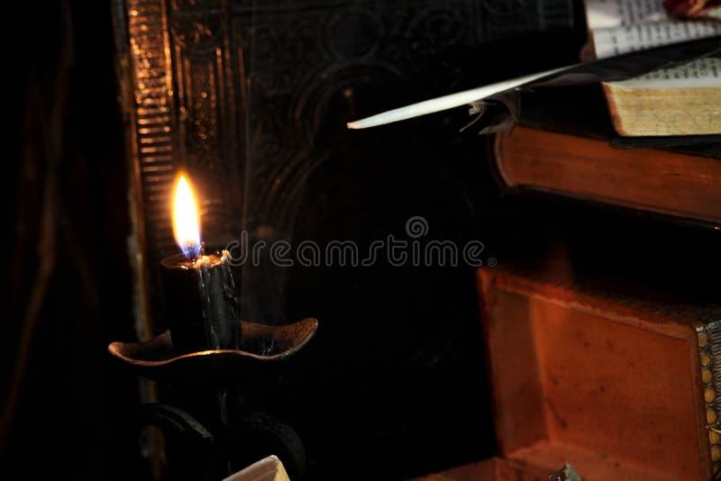 Black candle Magic Ritual stock photo. Image of feathers ...